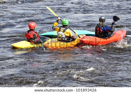 Shutter-speed surfing in a river at spring - stock photo