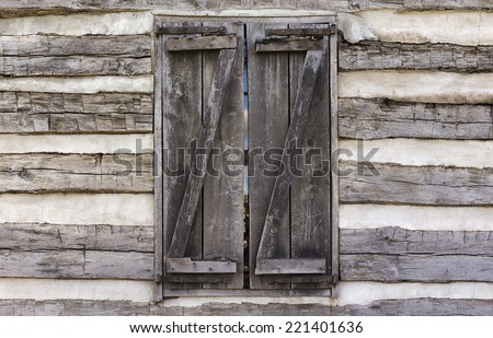 shuttered window of a log cabin background