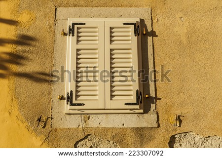 Shutters, closed shutters on the window to protect against heat and sun.  - stock photo