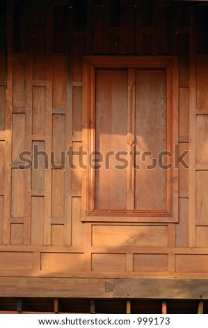 Shutters on a wooden Thai house