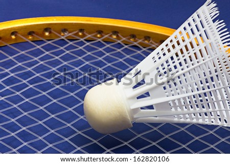 Shuttlecock and badminton  on the blue background - stock photo