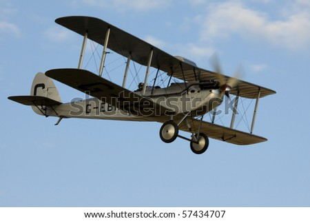 SHUTTLEWORTH, BEDFORDSHIRE - JULY 17: De Havilland DH-60X Hermes Moth G-BEWD in flight at the Evening Air Display on JULY 17, 2010 at Shuttleworth, Old Warden Park, Bedfordshire, UK.