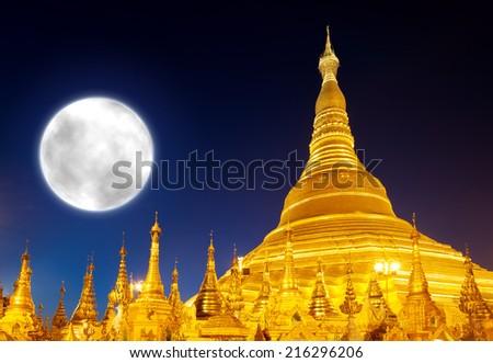 Shwedagon Pagoda and big moon in Yangon, Myanmar (Burma)  - stock photo