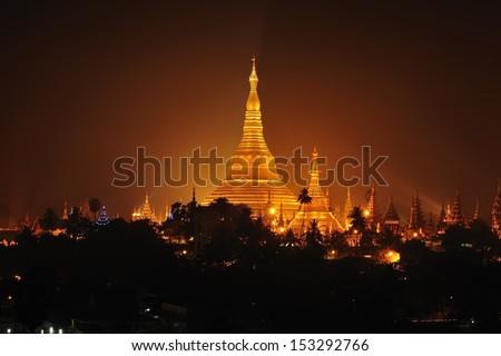 Shwedagon Pagoda in Yangon City, Burma with Beautiful Evening Light - stock photo