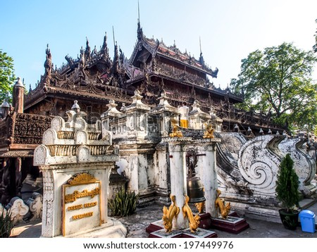Shwenandaw monastery or golden palace in Mandalay, Myanmar. This monastery is the only one monastery remaining from Mandalay palace.  - stock photo