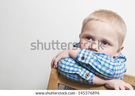 Shy and frightened little boy - stock photo