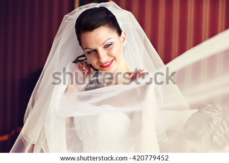 Shy and thoughtful - bride during a wedding preparations - stock photo