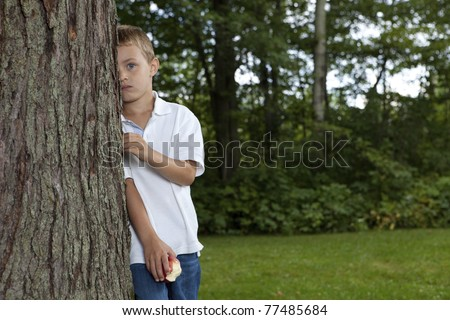 Shy boy - stock photo