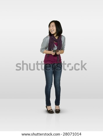 Shy female teen text messaging - stock photo