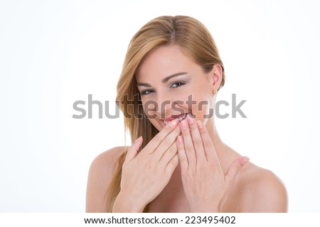 shy girl covers her mouth with two hands - stock photo