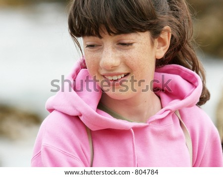 Shy girl with freckles - stock photo