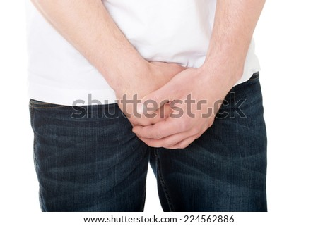 Shy man covering his crotch - stock photo