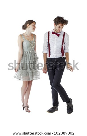 Shy teen girl and boy dressed formally for a prom bow slightly to each other. Vertical, isolated on white, copy space.