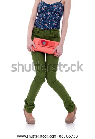shy woman wearing green jeans and high heels shoes - stock photo