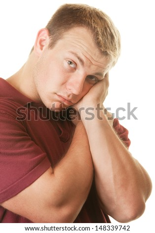 Shy young athletic man with head in hands - stock photo