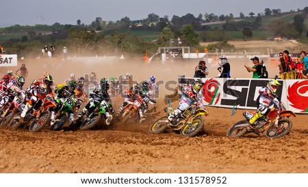 SI RACHA, THAILAND - MAR. 10 : Group of motocross riders at first curve during MX1/2 super final race of The FIM Motocross World Championship Grandprix of Thailand, on March 10, 2013. Thailand. - stock photo