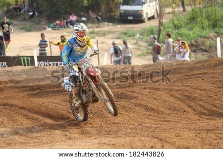 SI RACHA, THAILAND - MAR. 9 : Otsuka Gota (155), Japanese racer in action of MX2 race during The FIM Motocross World Championship Grandprix of Thailand, on March 9, 2014. Si Racha, Chonburi, Thailand. - stock photo