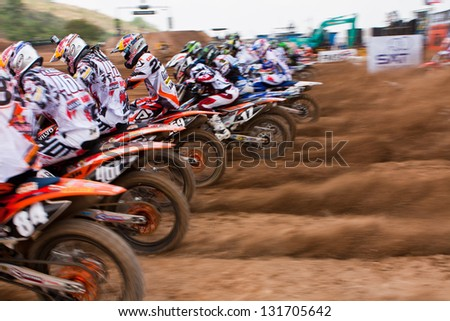 SI RACHA, THAILAND - MAR. 10 : The unidetified riders at start line in The FIM Motocross World Championship Grandprix of Thailand, on March 10, 2013. Thailand. - stock photo