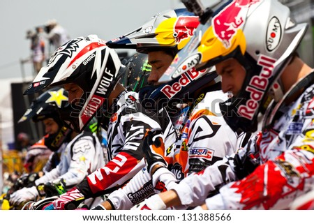 SI RACHA, THAILAND - MAR. 10 : unidentified riders at start line in The FIM Motocross World Championship Grandprix of Thailand, on March 10, 2013. Thailand - stock photo