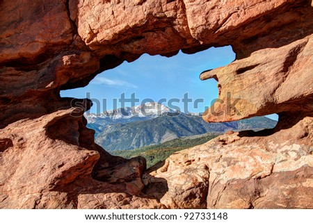Siamese Twins sandstone formation at Colorado Springs' Garden of the Gods, with Pikes Peak in background - stock photo