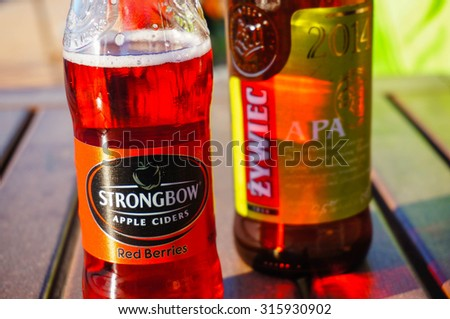 SIANOZETY, POLAND - JULY 27, 2015: Strongbow cider and Zywiec beer bottles on table - stock photo