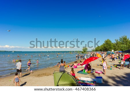 Sibbald Provincial Park, Ontario - August 6, 2016: Busy beach in Sibbald park on Lake Simcoe with many vacationers from southern Ontario and overseas