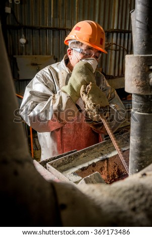 Siberia, Russia - August 13, 2014: moulting gold at a factory - stock photo