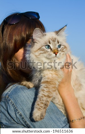 Siberian nevsky mask cat and young woman in a summer nature - stock photo