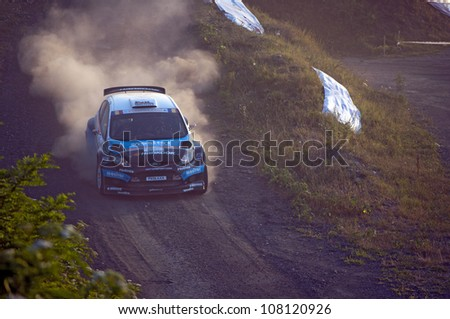 SIBIU - JULY 20: Flodin Patrick in his Ford Fiesta S2000 during 2012 IRC Intercontinental Rally Challenge - Eurosport on July 20, 2012 in Sibiu, Romania. - stock photo