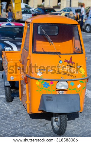 SIBIU - SEPTEMBER 09: Colored food delivery car in the center of Sibiu, city designated the European Capital of Culture for the year 2007. Sibiu, Romania on 09 September 2015