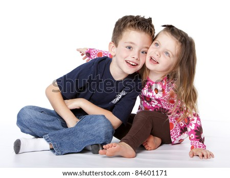 Siblings portrait isolated on a white background - stock photo
