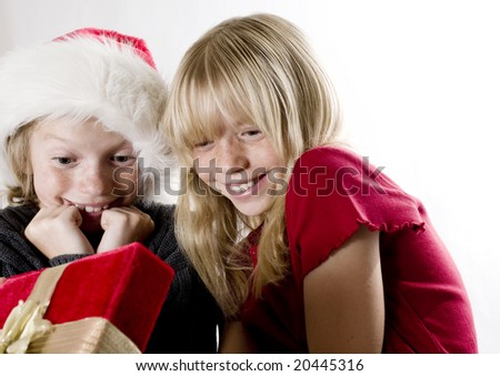 Siblings Sharing a Surprise on Christmas Morning! - stock photo
