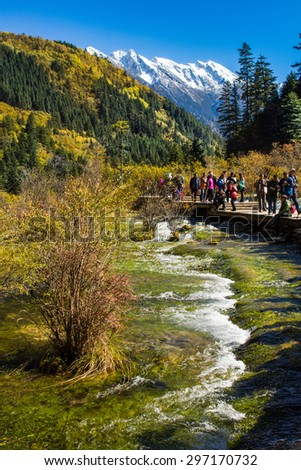 SICHUAN, CHINA - OCTOBER 23, 2014 : Tourist visit the Pearl Shoal Waterfall in Jiuzhaigou National Park scenery spot on October 23, 2014 in Jiuzhaigou, Sichuan, China. - stock photo