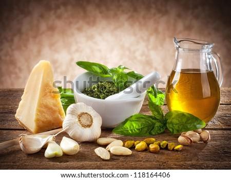 Sicilian pesto ingredients on wooden table - stock photo