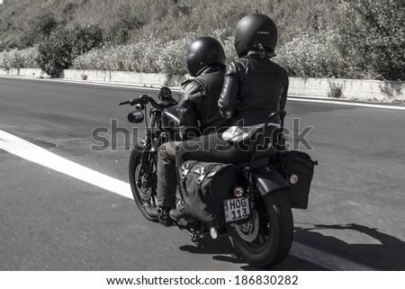 SICILY, ITALY - APRIL 7, 2014: H.O.G. Malta Chapter riding their Harley-Davidson motorcycles in Sicily. Harley Owners Group (H.O.G.) is made up of various local chapters from around the world. - stock photo