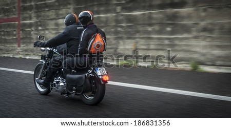 SICILY, ITALY - APRIL 6, 2014: Members of H.O.G. Malta Chapter on their Harley-Davidson motorcycles in Sicily. Harley Owners Group (H.O.G.) is made up of various local chapters from around the world. - stock photo