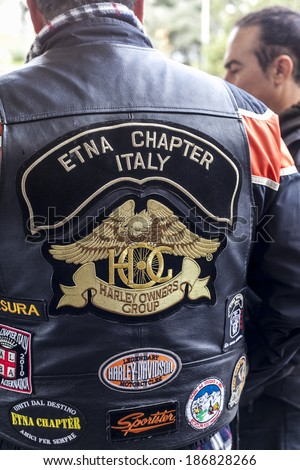 SICILY, ITALY - APRIL 6, 2014 - Members of the H.O.G. Etna Chapter in Sicily. Harley Owners Group (H.O.G.) is made up of various local chapters from around the world. - stock photo