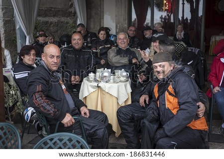 SICILY, ITALY - APRIL 5, 2014: Members of the H.O.G. Malta Chapter make a stop while on tour in Sicily. Harley Owners Group (H.O.G.) is made up of various local chapters from around the world. - stock photo