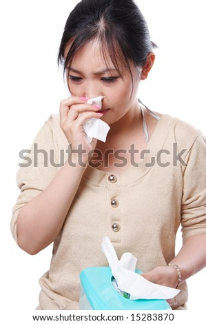 Sick asian woman blowing her nose with tissues, isolated on white - stock photo