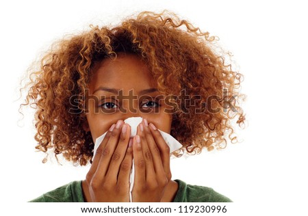 Sick black woman with a flu, sneezing closeup isolated over white - stock photo