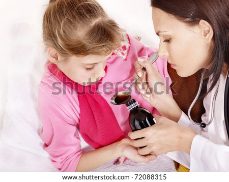 Sick child take  medicine with doctor. Isolated. - stock photo