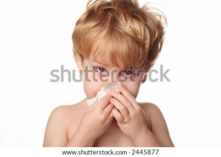 Sick Child wiping his nose - stock photo