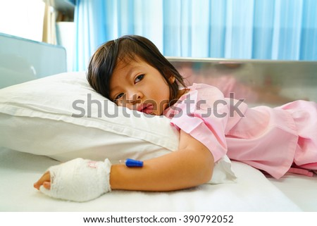 sick girl lying in bed,asian little girl 3 year old,selective focus, - stock photo