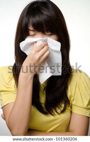 Sick girl on yellow shirt use tissue paper - stock photo