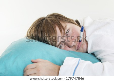 Sick Girl With Thermometer In Mouth Laying On Pillow - stock photo