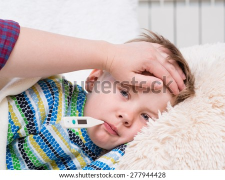 Sick kid high fever laying bed stock photo edit now shutterstock sick kid with high fever laying in bed and mother taking temperature altavistaventures Choice Image