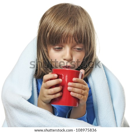sick little girl with a cup of tea - stock photo