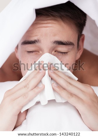 Sick man. Flu. Man caught cold. - stock photo