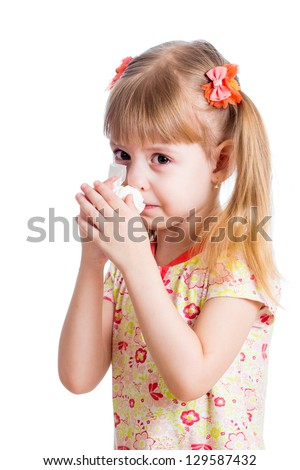 sick or crying kid wiping or cleaning nose with tissue isolated - stock photo