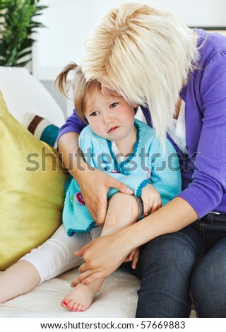Sick sad child lying on couch in living room - stock photo